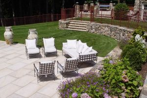 Earthscapes custom landscape design and masonry service of a backyard and lounge area