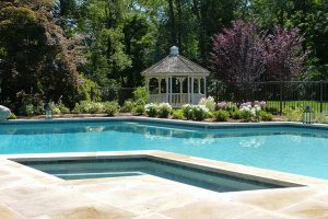 Earthscapes custom outdoor living service of a pool, hot tub, and gazebo for backyard in Westport, CT