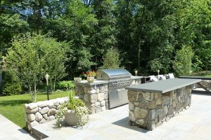 Earthscapes outdoor living remodeling service of a grill and patio design for a home in Weston, CT