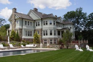 Earthscapes custom outdoor living and landscape design services of a pool, tanning deck, and backyard in Darien, CT