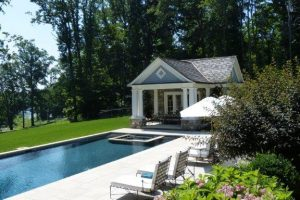 Earthscapes custom outdoor living and landscape design services of a pool, tanning deck, and backyard in New Canaan, CT