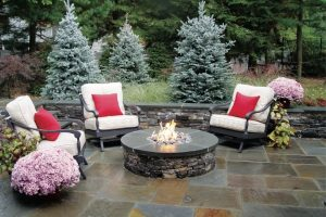 Earthscapes custom outdoor living patio design with a custom masonry work fire pit